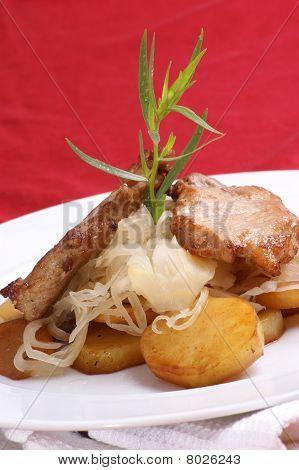 Organic Pork Chop, Sauerkraut And Roasted Potato