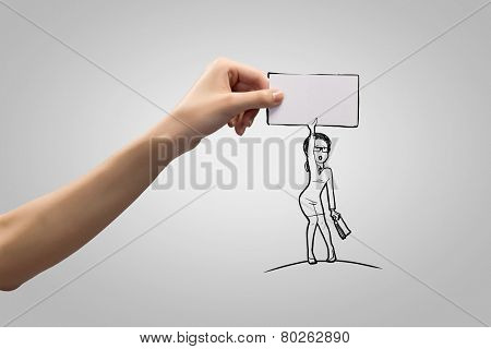 Human hand and caricature of funny businesswoman with banner