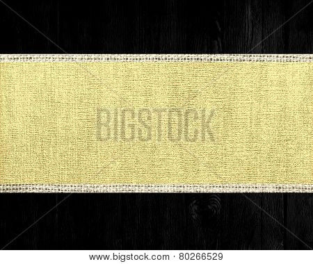 Mellow yellow and black burlap jute fabric textured background