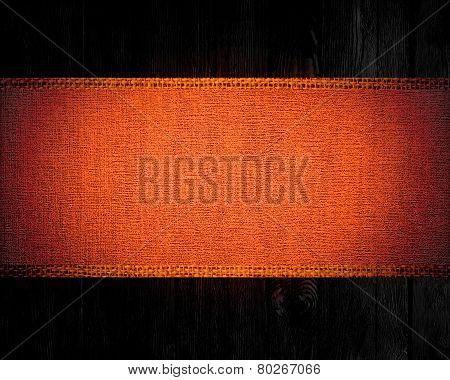 dark orange rustic canvas banner textured with dark wood background