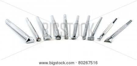 Tools for leather stamping, on white