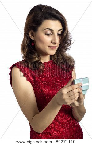 Young Woman Is Opening Her Birthday Present