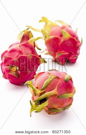 Three Whole Dragonfruits On White Background