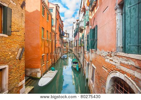 Gondolas Parked Next To Buildings In Venice