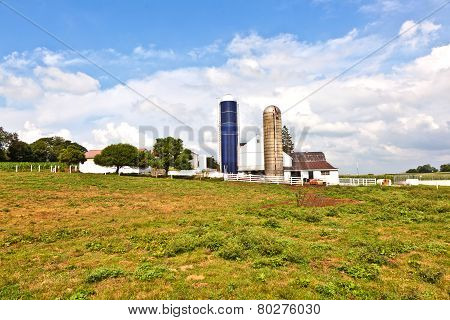 FARMSTEAD, USA - FEB 9, 2012: farm house with field and silo in beautiful landscape