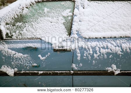 Snow Fals On Door Of Blue Car