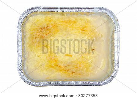 Lasagna in aluminium recipient isolated on white.