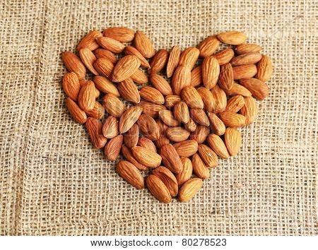 Almonds on sackcloth background