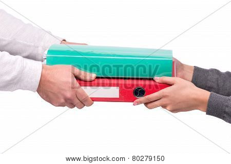 Hand giving folders to other person