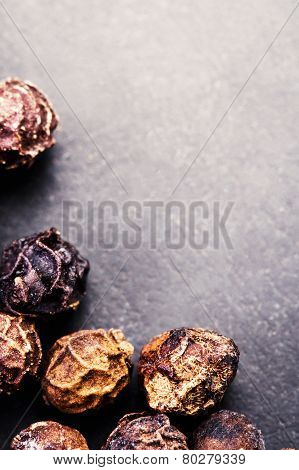 Black Peppercorns Closeup. Black Pepper On Dark Background With Copyspace