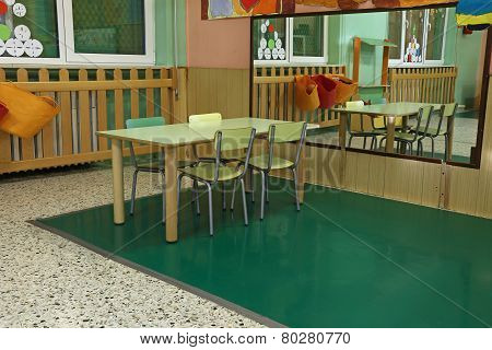 Table And Chairs In The Big Room Of The Nursery With A Mirror