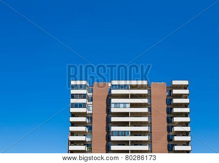 Balconies On Condos Under Clear Blue Sky