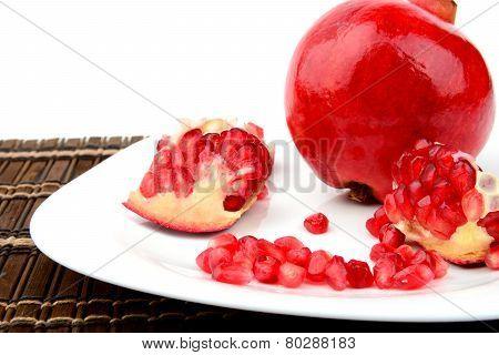 Studio Shot Open Pomegranate On Plate Wooden Mate