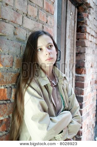 Upset Girl Near Brick Wall