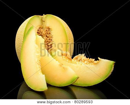 Melon Galia Notched With Slices Isolated Black In Studio