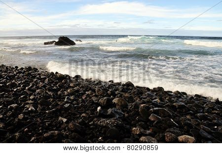 Waves On A Stony Beach