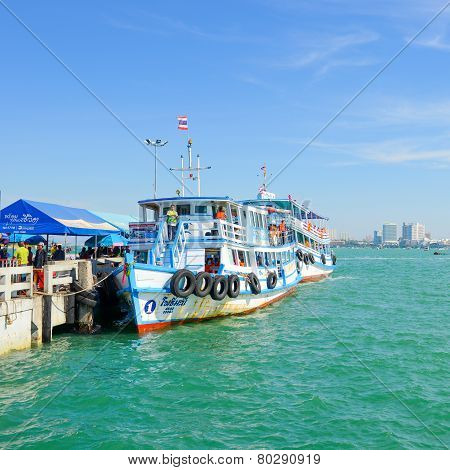 Passenger Ship At Boat Park For Visitors To The Harbor With Coast Of Pattaya City.