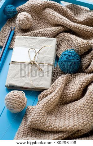 One Old Notebook In Knitted Cover Lie Next To The Coil Bright Filaments And Blanket Knitted On Blue