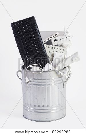 Garbage Can Filled With Obsolete Office Equipment