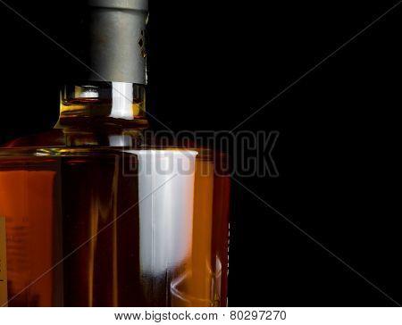 Whiskey Bottle On Black Background