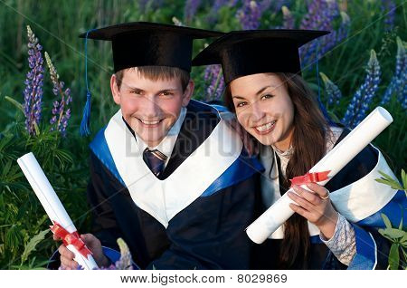 Two Smiley Graduate Outdoors