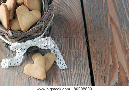 Handmade Heart Cookies For Valentine's Day In A Basket On A Wooden Table