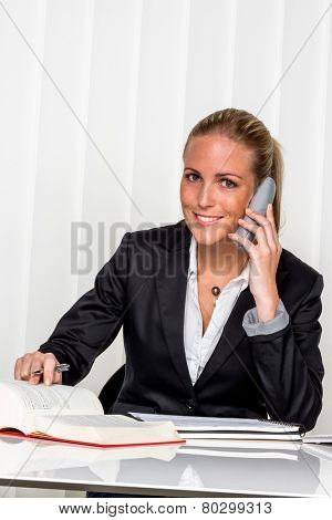 businesswoman sitting in an office. photo icon for managers, independence or lawyer.