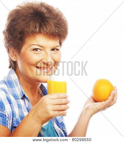 Mature smiling woman with orange juice