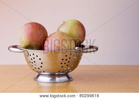 Ripe braeburn apples in a colander