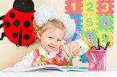 pic of kindergarten  - Cute child girl drawing with colorful pencils and felt - JPG