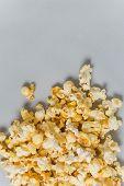 foto of popcorn  - Full popcorn in classic popcorn box on grey background - JPG