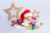 image of christmas baby  - Beautiful little baby celebrates Christmas - JPG