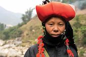 picture of hmong  - Woman from Red Dao minority group wearing traditional headdress in Sapa - JPG