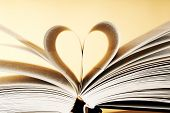 stock photo of two hearts  - Two pages of a book forming the shape of a heart - JPG