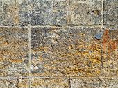 picture of wall-stone  - Old concrete weathered worn walls lined with natural stone. Grungy Concrete Surface. Great background or texture.