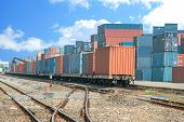 image of railroad car  - Cargo train platform with freight train container at depot - JPG