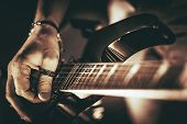 stock photo of guitar  - Guitarist Plays - JPG