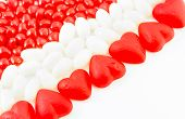 pic of jelly beans  - Valentine candies of Jube and Cinnamon Hearts and white jelly beans on white background - JPG