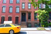 stock photo of west village  - West Village in New York Manhattan building yellow cab USA NYC - JPG