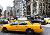 stock photo of cabs  - New York city Manhattan Fifth Avenue 5th Av yellow taxi cab US - JPG