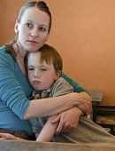 image of crying boy  - Mother holds sad little boy close - JPG