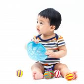 stock photo of non-toxic  - Cute asian baby playing toy isolated on white - JPG
