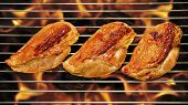 pic of flame-grilled  - Grilled chicken breast on the flaming grill - JPG