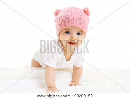 Portrait Of Sweet Baby Crawls In The Pink Knitted Hat