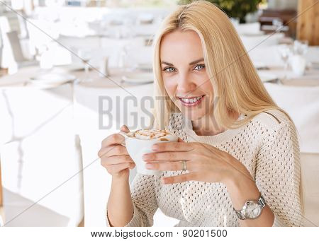 Beautiful Young Lady With Cup Of Morning Coffee Cappuccino In Cafe