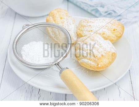 Sugar Powdered Madeleines On The White Plate