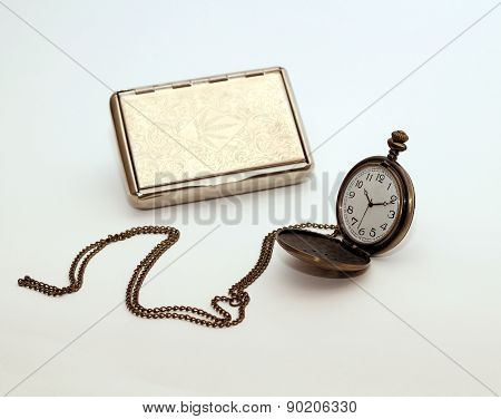 old chain watch and metal cigarette case