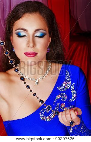 Oriental Beauty Holding Jewelery
