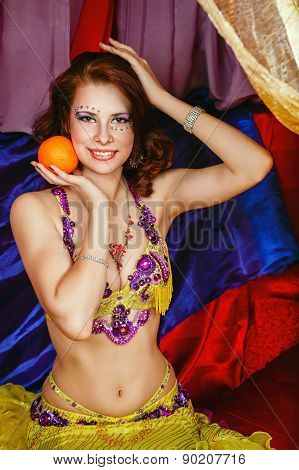 Oriental Beauty Is Holding An Orange