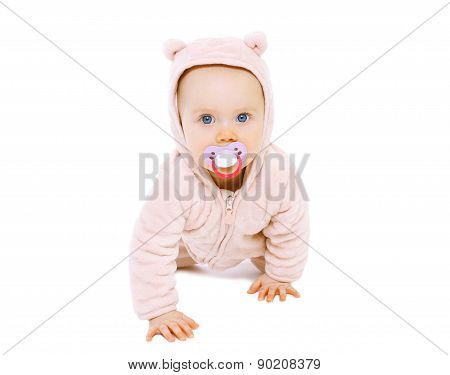 Cute Baby With Pacifier Crawls On A White Background